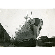 Black and White Photograph in album of ship 'Aberdonian Coast' being repainted at dockside