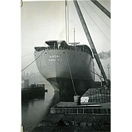 Black and White Photograph in album of 'Vikdal' stern tied up alongside Hall Russell's shipyard