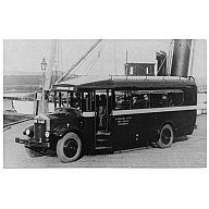 photograph taken at Warehouse Pier, Stromness, with special bus in foreground and parts of 'St Ola' (I) visible behind.