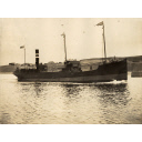 Photograph in album showing John Lewis built vessel Freeland